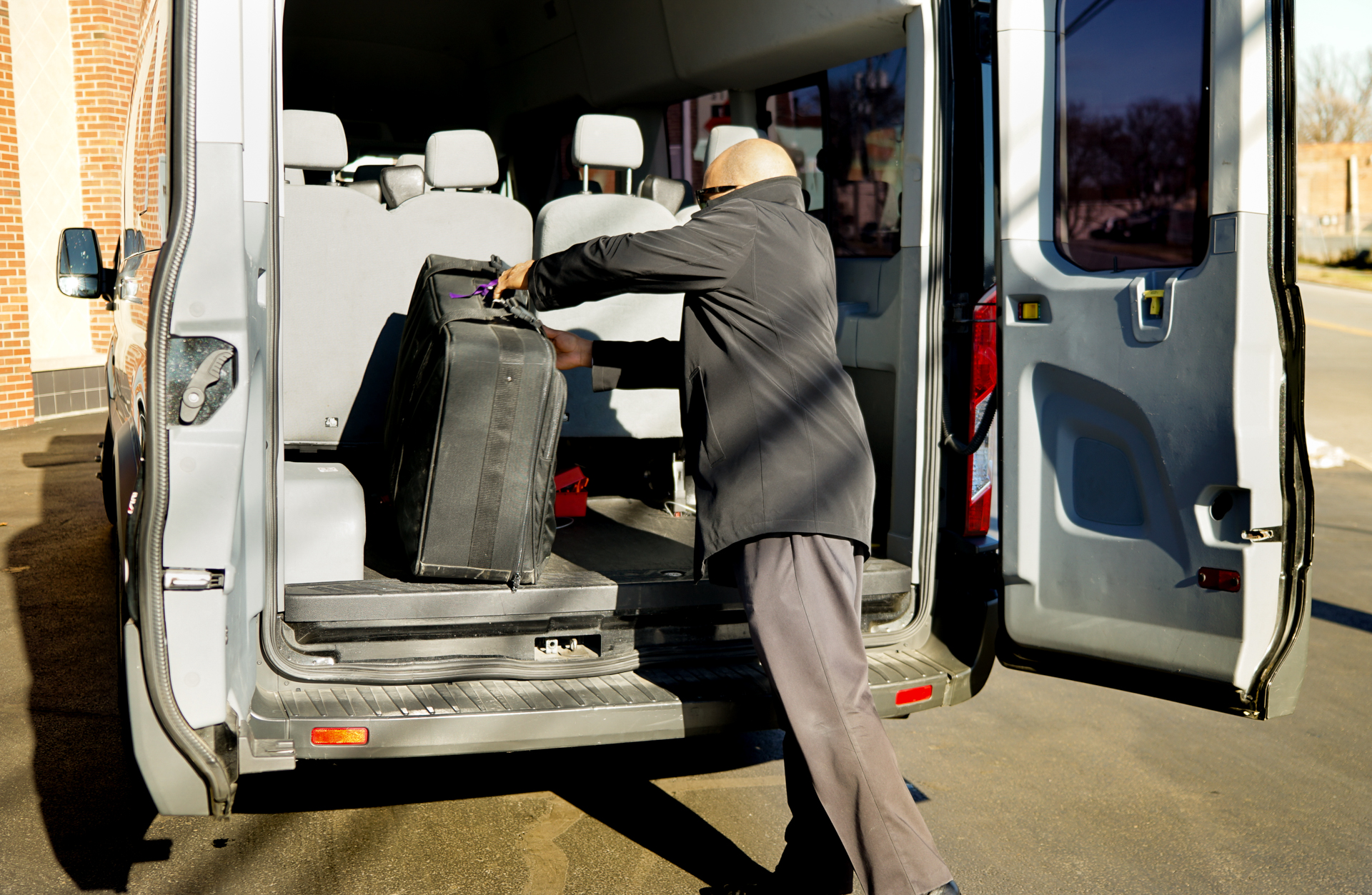 LOADING LUGGAGE INTO OUR SHUTTLE VAN