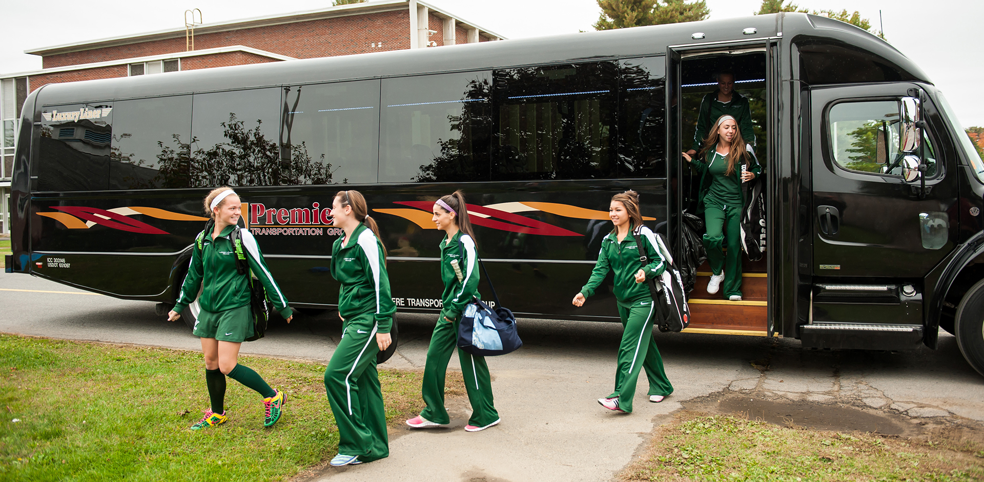 Girls team exits bus