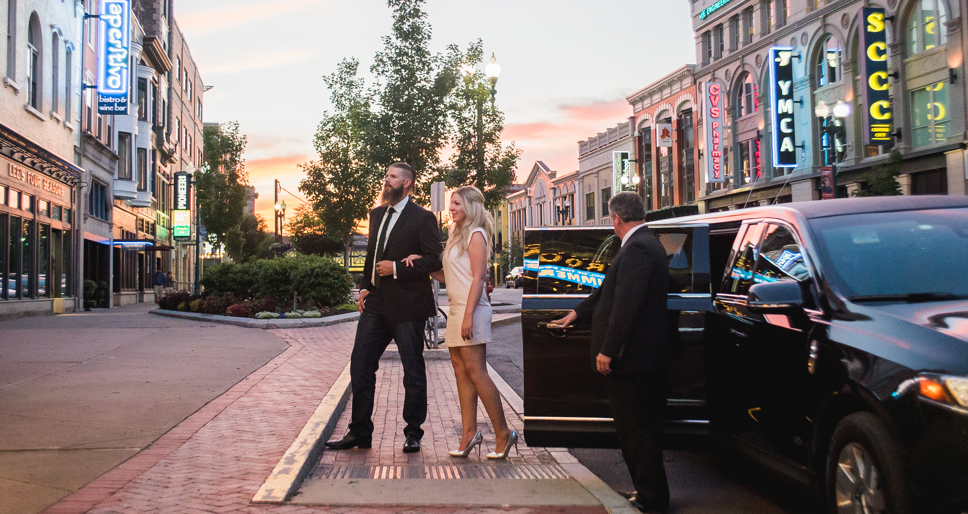 Couple exiting limousine