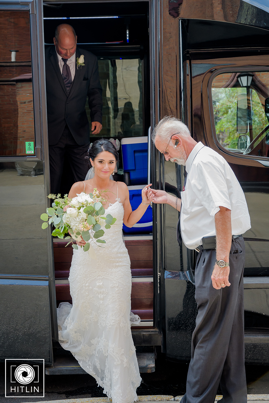 Bride getting off bus